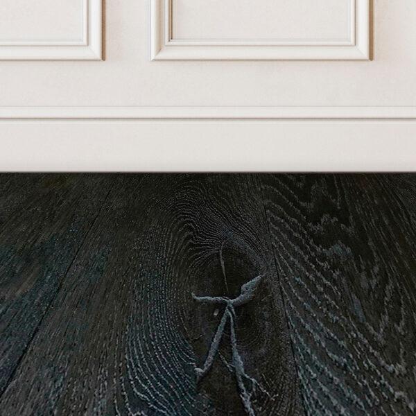 Noir-black-wood-floor-sample-on-white-wall