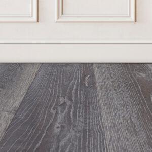 Squamish-grey-wood-floor-sample-on-white-wall