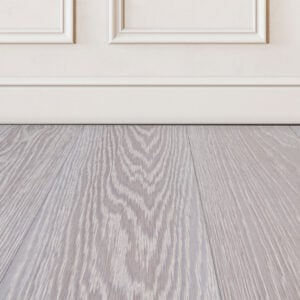 Valeryn-grey-wood-floor-sample-on-white-wall