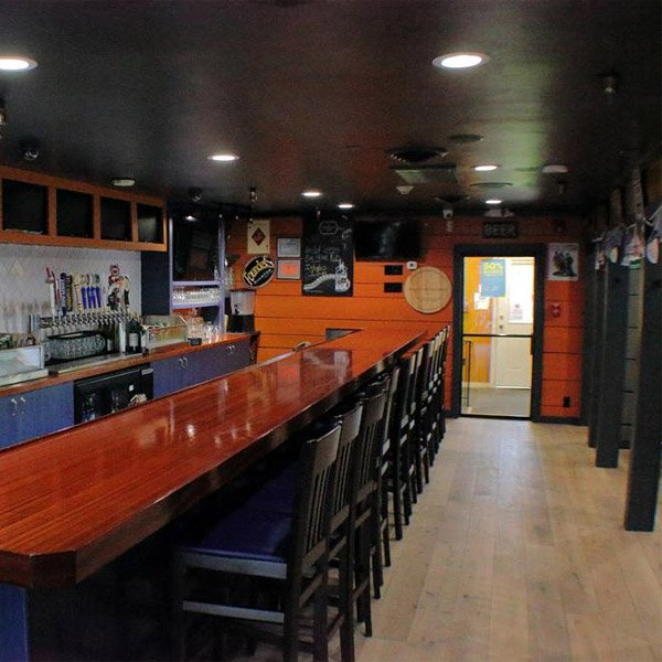 The interior of J&R's Steakhouse with Longhorn hardwood floors.