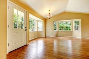 Large empty newly remodeled living room with wood floor.