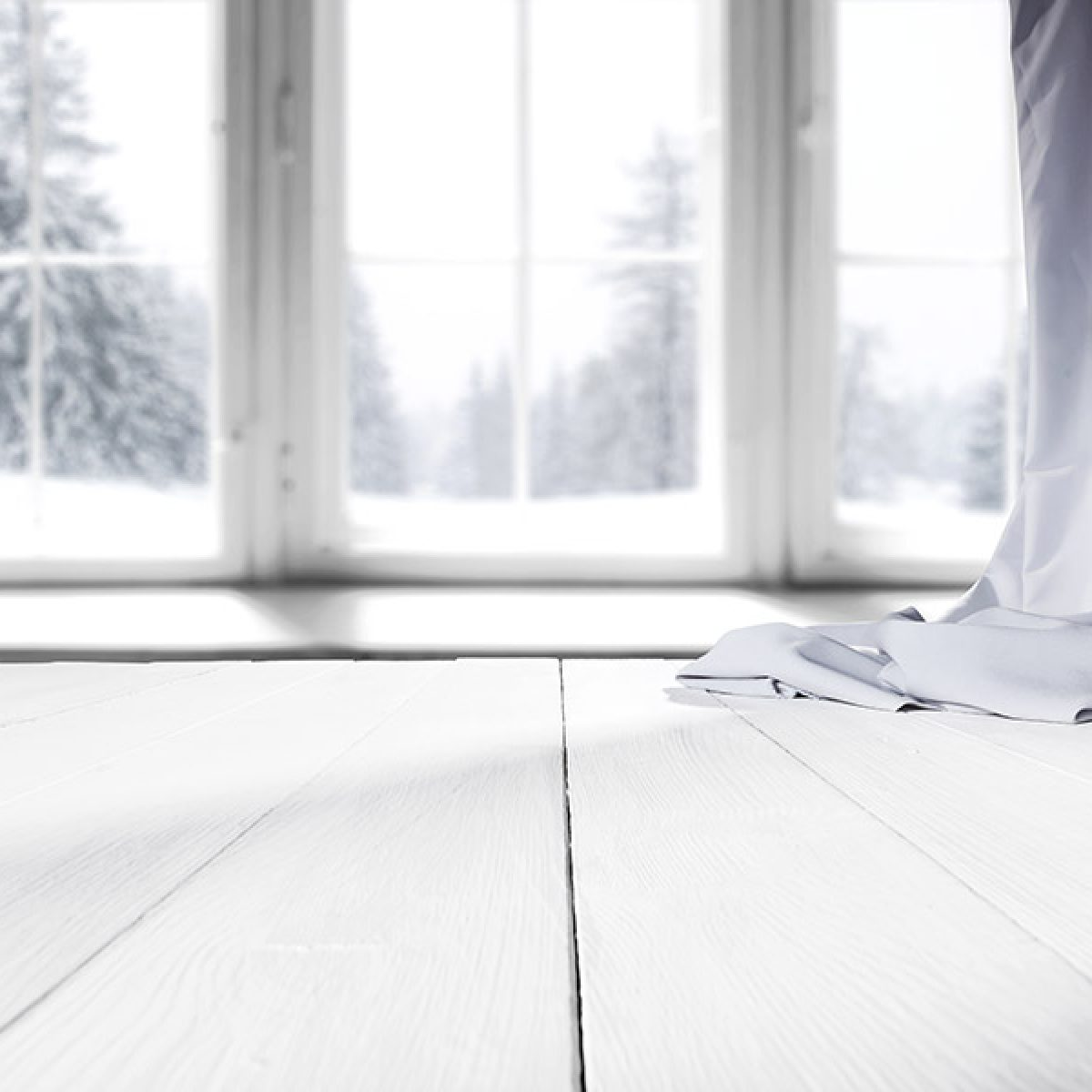 Gap in White Hardwood Flooring During Winter